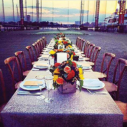 In 2014, the golf driving range transformed into a private dining hall honoring renowned golfer Sir Nick Faldo. Client Glenmorangie hosted an intimate dinner featuring the single malt whisky, Abigail Kirsch catering, and a Hudson River sunset.