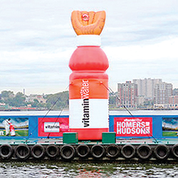 """During the 2008 Major League Baseball All Star Game, Vitamin Water hosted a """"Homers on the Hudson"""" event directly off Pier 61. This major media event, which included a floating barge and themed target, attracted MLB All Stars, celebrities and local fans who attempted to win a million dollars by batting a baseball into an oversized, inflatable baseball glove."""