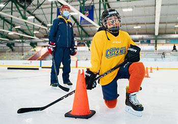 Hockey player kneeling on the ice